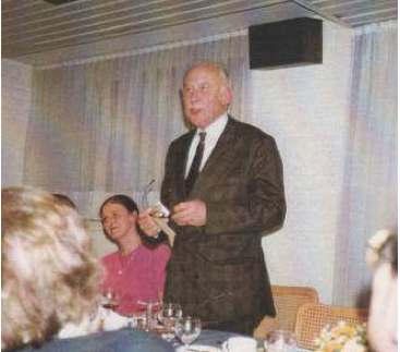 Photo of Marcel Seynave talking at a meeting