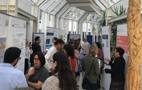 Picture from a poster session with people